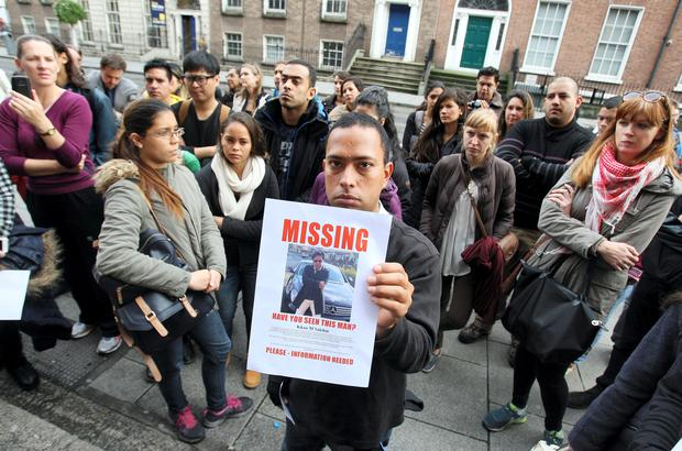 A student holding a poster of Khan M Salehin,Managing Director of the closed Leinster College on Harcourt street which is a cause of concern to students and teachers who protested outside the building yesterday