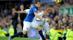 Swansea City's Jefferson Montero (rear) and Everton's Seamus Coleman battle for the ball during the Barclays Premier League match at Goodison Park