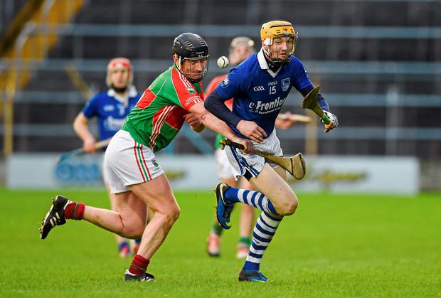 Lar Corbett attempts to get away from David Kennedy of Loughmore-Castleiney. during the Tipperary SHC final. Photo: Diarmuid Greene / SPORTSFILE