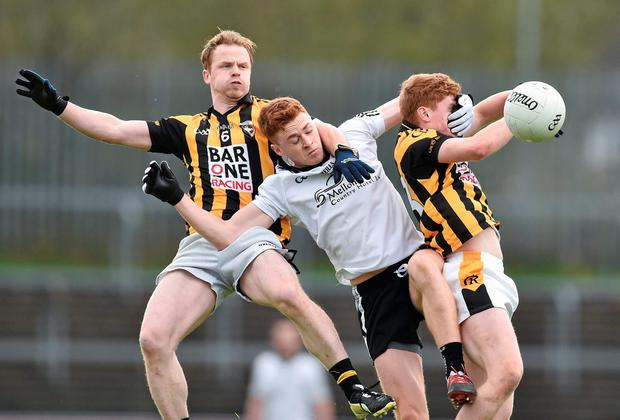 Conor Meyler of Omagh St Endas rises with Crossmaglen Rangers duo Paul McKeown and Padraig Studdard to win an aerial challenge during the Ulster SFC quarter-final. Picture credit: Ramsey Cardy / SPORTSFILE
