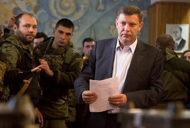 Pro-Russian rebel leader Alexander Zakharchenko prepares to casts his ballot, he won the election with 79pc of the vote