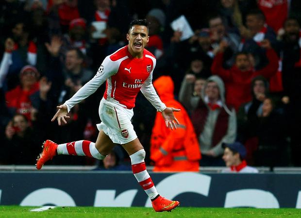 Arsenal's Alexis Sanchez celebrates after scoring his team's second goal against Anderlecht during their Champions League soccer match at the Emirates stadium in London November 4, 2014. REUTERS/Eddie Keogh (BRITAIN - Tags: SOCCER SPORT)