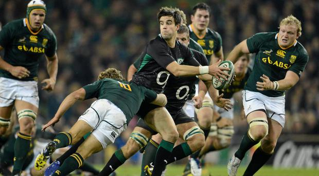 Conor Murray, Ireland, is tackled by Pat Lambie, South Africa, November 2012