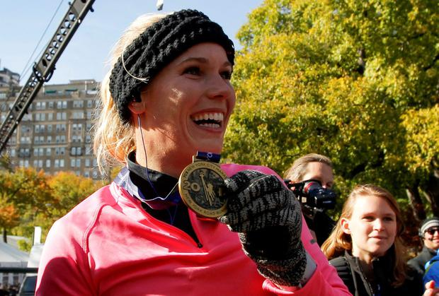 Caroline Wozniacki shows her medal after finishing the New York City Marathon