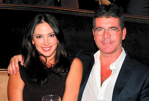 Music mogul Simon Cowell with his girlfriend Lauren Silverman.