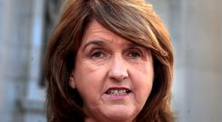 Labour leader Joan Burton,TD ,Tanaiste and Minister for Social Protection meets the media at Government Buildings yesterday.