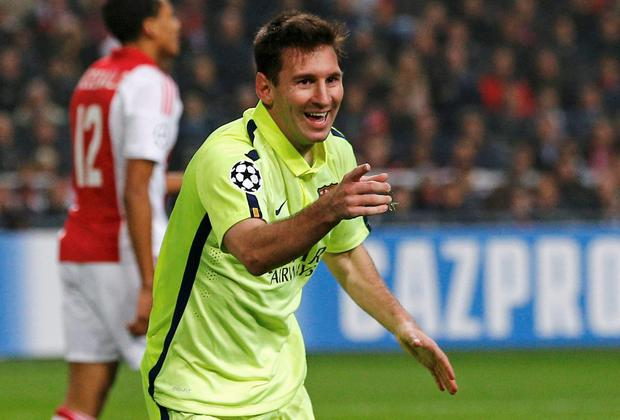 941b03ebac5 Messi equals Raul's record with brace at Ajax. Barcelona's Lionel Messi  celebrates his goal during against Ajax. REUTERS/Michael Kooren