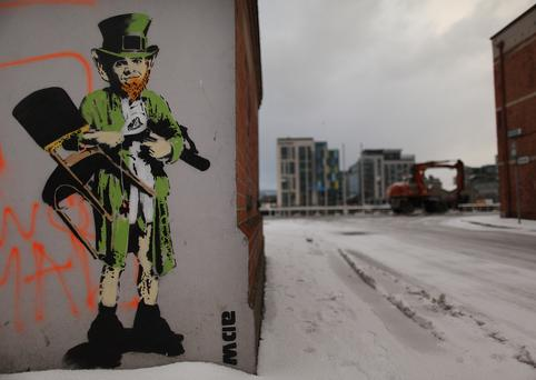 A street artist's picture of a traditional Leprechaun is daubed on a wall of an empty building in the docklands area on 1 December, 2010 in Dublin