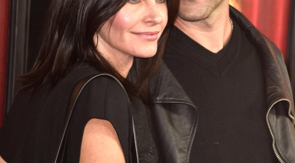 Actress Courteney Cox (L) and musician Johnny McDaid arrive premiere of HBO's