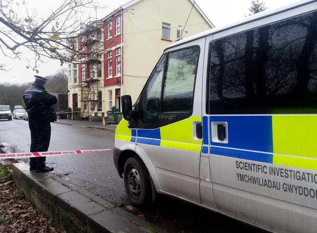 Police outside the Sirhowy Arms Hotel in Argoed, Blackwood, south Wales, where a man and a woman died after police were called to deal with reports of an assault