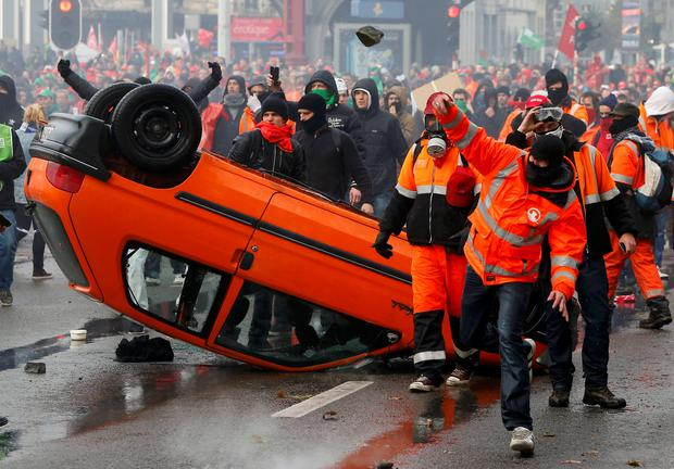 Fury against austerity boiled over on the streets of Brussels when a march attended by 130,000 protesters flared into violence in the Belgian capital. Photo: Reuters