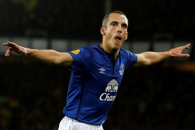 Everton's Leon Osman celebrates after scoring the opening goal during their Europa League soccer match against Lille