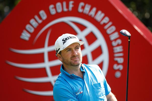 Graeme McDowell of Northern Ireland tees off on the third hole during the second round of the WGC-HSBC Champions golf tournament in Shanghai November 7, 2014