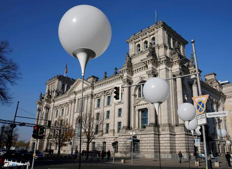 Stands with balloons are placed along the former Berlin Wall location in front of the Bundestag lower house of parliament building, and will be used in the installation 'Lichtgrenze' (Border of Light) in Berlin