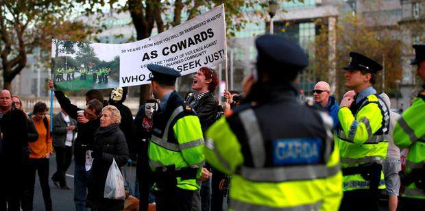 A group of protesters and gardai pictured outside the Four Courts after a High court action involving Irish Water. Pic: Courts Collins