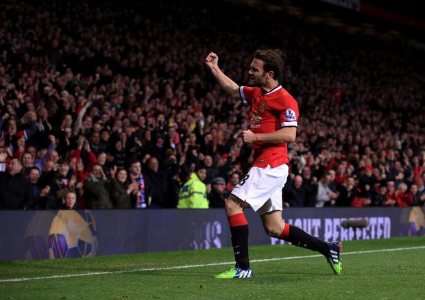 Manchester United's Juan Mata celebrates scoring his side's winner against Crystal Palace.