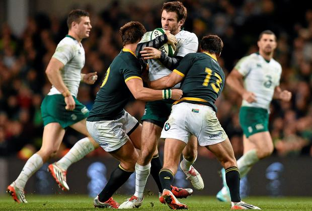 Ireland centre Jared Payne is tackled by South African pair Handré Pollard and Jan Serfontein in their clash at the Aviva. Photo: Ramsey Cardy / SPORTSFILE