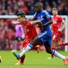Liverpool's Philippe Coutinho and Chelsea's Ramires battle for the ball