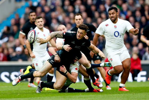 Sonny Bill Williams offloads the ball as he is tackled during New Zealand's win over England at Twickenham. Photo: Phil Walter/Getty Images