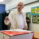 Janusz Korwin-Mikke, leader of the eurosceptic Congress of the New Right party, casts his ballot for the European Parliament elections at a polling station in Warsaw.