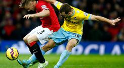 Luke Shaw battles it out with James McArthur at Old Trafford. Photo credit: Clive Rose/Getty Images