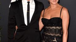 Actor Justin Theroux (L) and actress Jennifer Aniston attend the Academy Of Motion Picture Arts And Sciences' 2014 Governors Awards