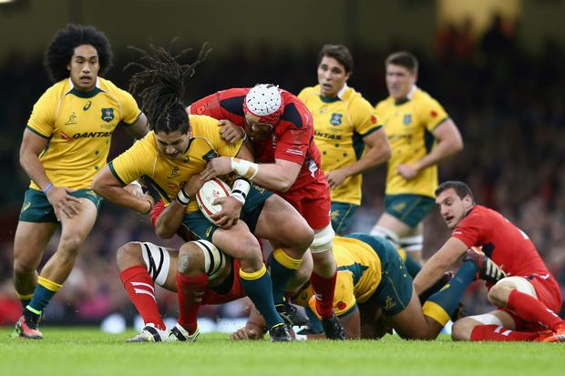 Saia Fainga'a of Australia is held up by Jake Ball of Wales during the International match between Wales and Australia at the Millennium Stadium on Saturday