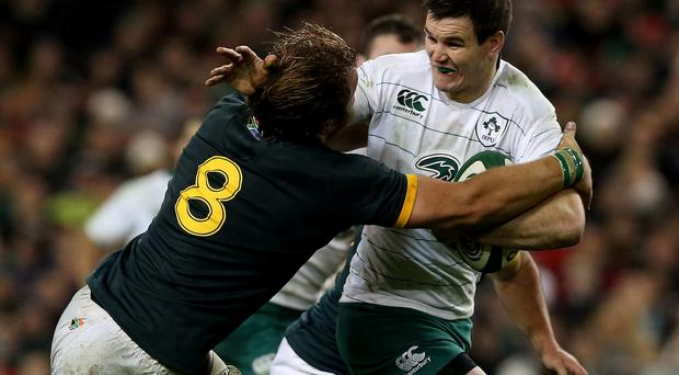 Ireland's Jonathan Sexton is tackled by South Africa's Duane Vermeulen (right) during the Guinness Series match at the Aviva Stadium on Saturday