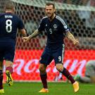 Scotland's Scott Brown (L) and Steven Fletcher celebrate scoring during the UEFA Euro 2016 Group D qualifyier against Poland. Photo credit: JANEK SKARZYNSKI/AFP/Getty Images
