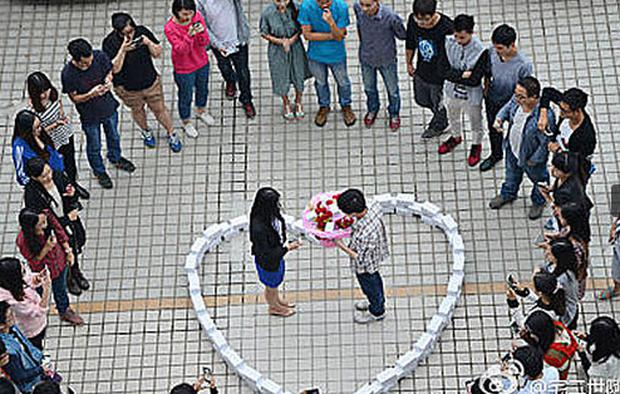 The man proposing to his girlfriend. Unfortunately it didn't go well