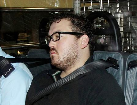 Rurik Jutting, a 29-year-old British banker who has been charged with two counts of murder, sits in a police van as it arrives at a court in Hong Kong earlier this month