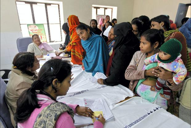 Women queue up for sterilisation at a hospital in India. In order to keep the population in check prizes have been offered to encourage women to avail of birth-control procedures.