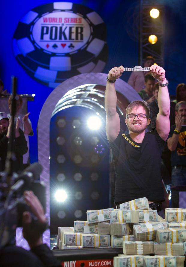Martin Jacobson, 27, of Sweden holds up his championship bracelet after beating Felix Stephensen of Norway to win the $10 million first prize during the 2014 World Series of Poker main event at the Rio hotel-casino in Las Vegas, Nevada, November 11, 2014. REUTERS/Las Vegas Sun/Steve Marcus (UNITED STATES - Tags: SOCIETY) LAS VEGAS OUT