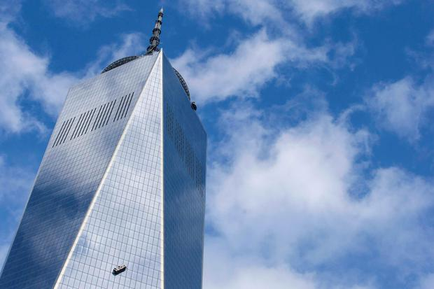 Stranded window washers hang on the side of One World Trade Center November 12, 2014. REUTERS/Brendan McDermid