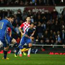 Lionel Messi of Argentina scores form a penalty during the friendly between Argentina and Croatia at Upton Park.