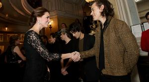 Catherine, Duchess of Cambridge meets boy band One Direction at The Royal Variety Performance at the London Palladium