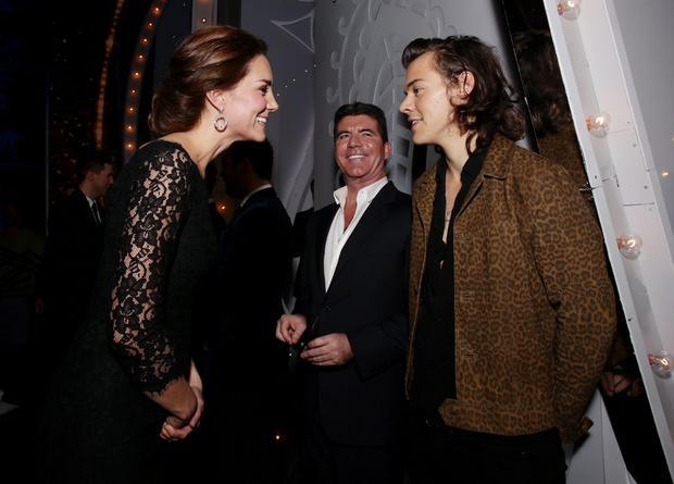 The Duchess of Cambridge meeting Harry Styles of One Direction as Simon Cowell looks on at the end of the Royal Variety Performance at the Palladium Theatre