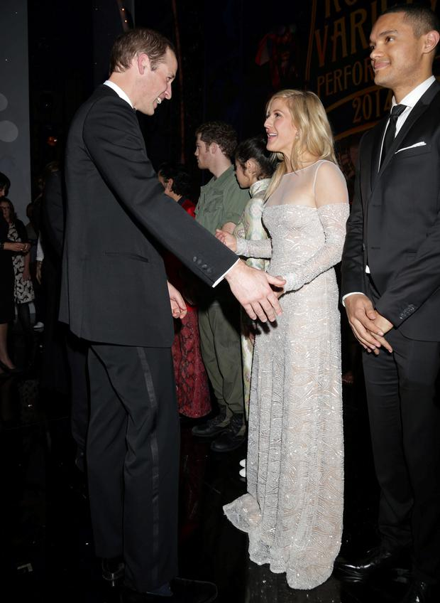 The Duke of Cambridge meets singer Ellie Goulding at the end of the Royal Variety Performance at the Palladium Theatre