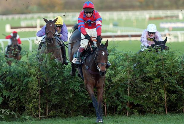 Balthazar King, under Richard Johnson, jumps the last ahead of runner-up Uncle Junior (Patrick Mullins) on the way to victory at Cheltenham yesterday. David Davies/PA Wire