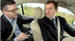 Enda Kenny speaks with Mark Kennelly while on the campaign trail in 2011