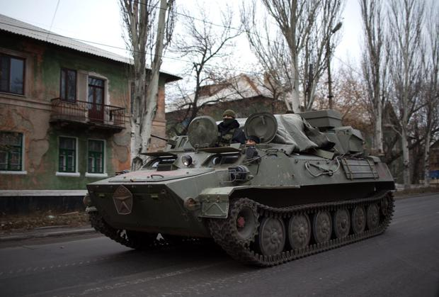 An armored personnel carrier (APC) on a main road in rebel-territory near the village of Torez, east of Donetsk, in eastern Ukraine