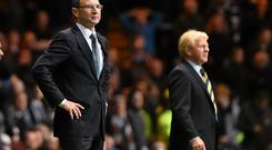 Martin O'Neill watches the action from the touchline at Parkhead with his Scottish counterpart Gordon Strachan in the background during the clash in November