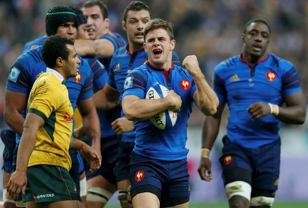 France's Teddy Thomas (C) reacts after Frances defeated Australia in their rugby union test match at the Stade de France