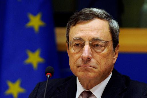 ECB President Mario Draghi waits to take the flloor during the Quarterly Hearing before the Committee on Economic and Monetary Affairs of the European Parliament in Brussels November 17, 2014