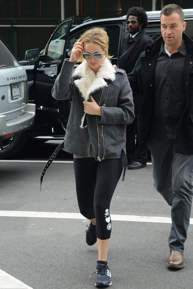 She opted for low-key cool with a grey coat and fur lining for a gym outing in NY