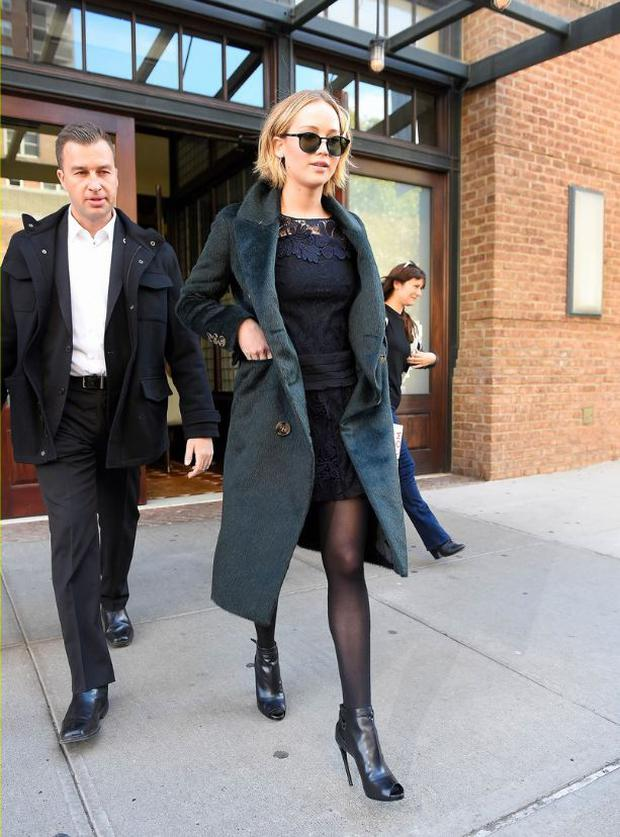 Leaving New York's Greenwich Hotel, she wears a lace navy dress and Leisure Society by Shane Baum sunglasses