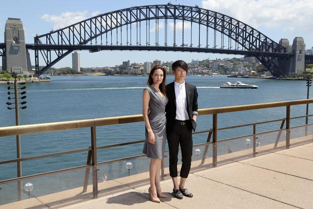 Hollywood star Angelina Jolie poses for photos with Japanese musician Miyavi in front of Australia's iconic landmark Harbour Bridge