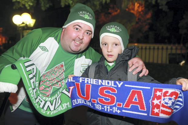 Fans Ian McCormack and his 8 year old son Alex, Lucan on their way to the friendly international between Ireland and the USA at the Aviva stadium in Dublin. Picture:Arthur Carron