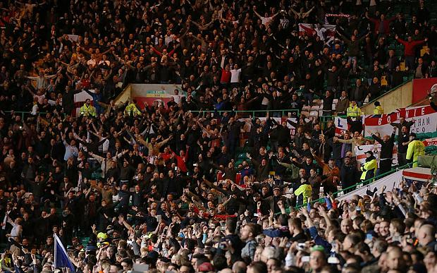 The England band have sparked controversy by playing music to anti-IRA songs during the game with Scotland at Celtic Park