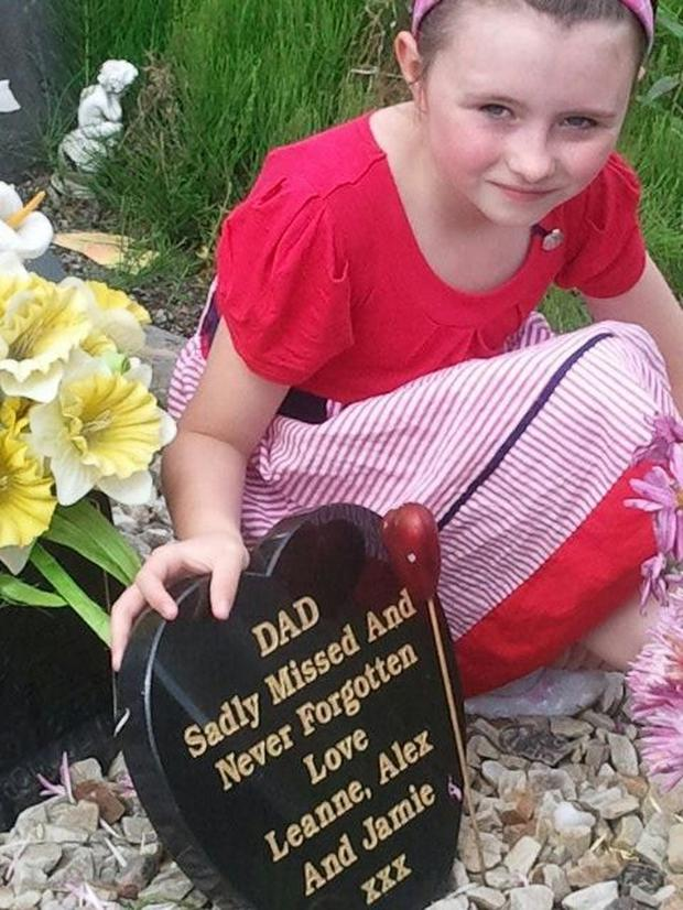 Alex Featherston at the grave of her father Andy Morgan. Photo: Andy Morgan Foundation
